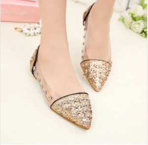 Pointed gold flats with stars studs